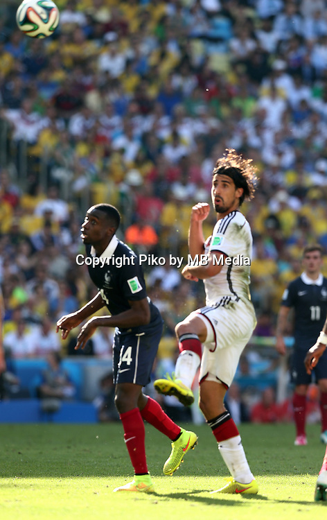 Fifa Soccer World Cup - Brazil 2014 - <br /> FRANCE (FRA) Vs. GERMANY (GER) - Quarter-finals - Estadio do Maracana Rio De Janeiro -- Brazil (BRA) - 04 July 2014 <br /> Here French player Blaise MATUIDI (L) and German player Sami KHEDIRA (R)<br /> &copy; PikoPress