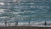 Along Highway 1, at Mendocino California visitors, tourists, frolic at the beach.