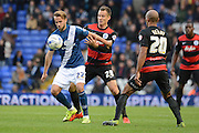 Birmingham City midfielder Andrew Shinnie holds off Queens Park Rangers midfielder Daniel Tozser during the Sky Bet Championship match between Birmingham City and Queens Park Rangers at St Andrews, Birmingham, England on 17 October 2015. Photo by Alan Franklin.