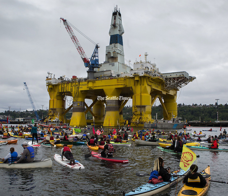 Activists in kayaks protest the Polar Pioneer, Shell&rsquo;s giant oil rig, which was moored at the Port of Seattle&rsquo;s Terminal 5 on May 16, 2015. <br /> Ellen M. Banner / The Seattle Times