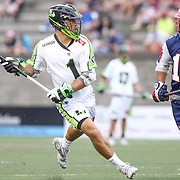JoJo Marasco #1 of the New York Lizards keeps the ball away from Matt Smalley #11 of the Boston Cannons during the game at Harvard Stadium on July 19, 2014 in Boston, Massachusetts. (Photo by Elan Kawesch)