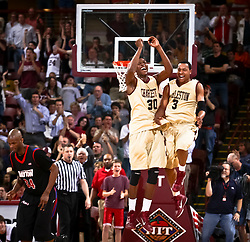 College of Charleston's Antwaine Wiggins and Andrew Goudelock celebrate during their game against Dayton in the first round of the NIT Tuesday, March 15 at Carolina First Arena.