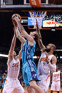 Jan 6, 2016; Phoenix, AZ, USA; Charlotte Hornets center Cody Zeller (40) goes up with the basketball against Phoenix Suns forward Jon Leuer (30) and center Tyson Chandler (4) in the first half of the game at Talking Stick Resort Arena. The Phoenix Suns defeated the Charlotte Hornets 111-102. Mandatory Credit: Jennifer Stewart-USA TODAY Sports