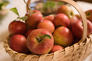 Red apples in a wooden basket.