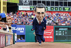 March 29, 2018 - Arlington, TX, U.S. - ARLINGTON, TX - MARCH 29: The Texas Rangers Legends mascot race caricature of George W Bush races between innings during the game between the Texas Rangers and the Houston Astros on March 29, 2018 at Globe Life Park in Arlington, Texas. Houston defeats Texas 4-1. (Photo by Matthew Pearce/Icon Sportswire) (Credit Image: © Matthew Pearce/Icon SMI via ZUMA Press)