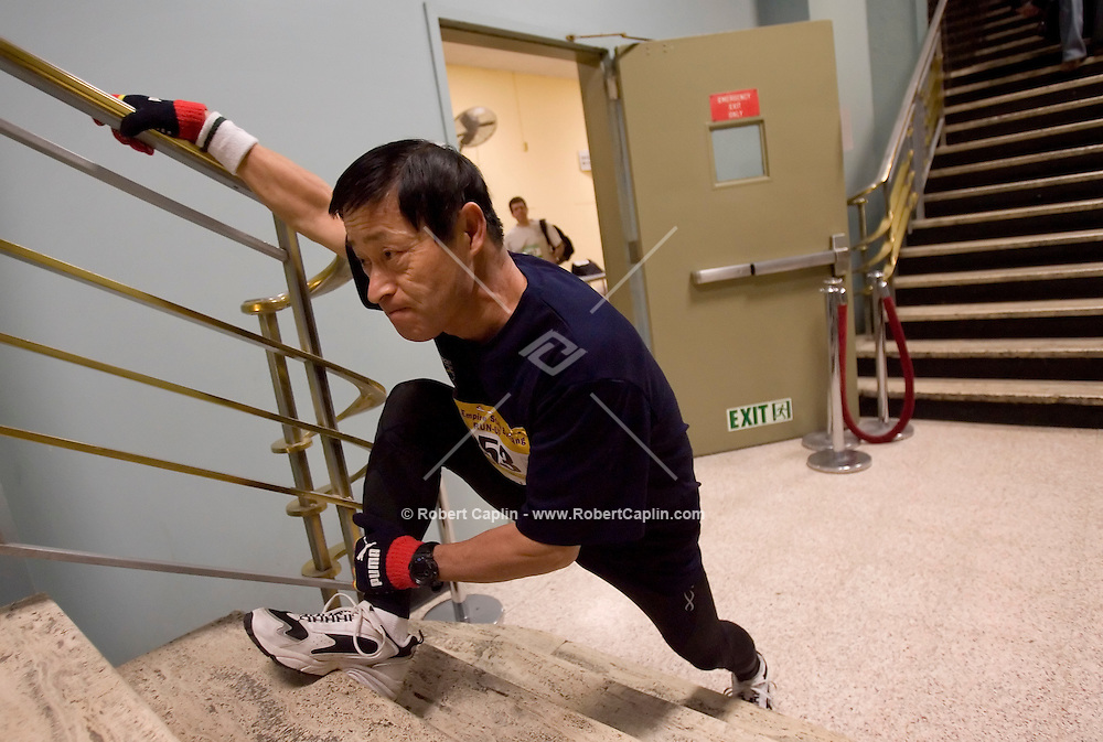 Kazuhiro Oga of Japan stretches before taking part in the thirteenth annual Empire State Building Run-Up Tueday, Feb. 6, 2007.