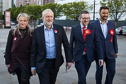 © Licensed to London News Pictures . 05/05/2017. Manchester, UK.  REBECCA LONG-BAILEY , Labour Party Leader JEREMY CORBYN , ANDREW GWYNNE and AFZAL KHAN arrive in Manchester following Andy Burnham's victory in the Manchester Metro mayoralty campaign , for a Momentum Rally on the steps of the Manchester Convention Centre . Andy Burnham did not attend . Photo credit: Joel Goodman/LNP