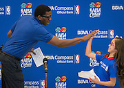 Former NBA player Felipe Lopez high-fives with 4th grader Alyssa Martinez at the start of a financial education and success program sponsored by NBA Cares and BBVA Compass at Crespo Elementary School, February 27, 2014.