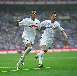 LONDON, ENGLAND - Saturday, May 30, 2011: Swansea City's Scott Sinclair celebrates his hat-trick, with team-mate Fabio Borini, as he scores the fourth goal against Reading from the penalty spot to seal victory during the Football League Championship Play-Off Final match at Wembley Stadium. (Photo by David Rawcliffe/Propaganda)