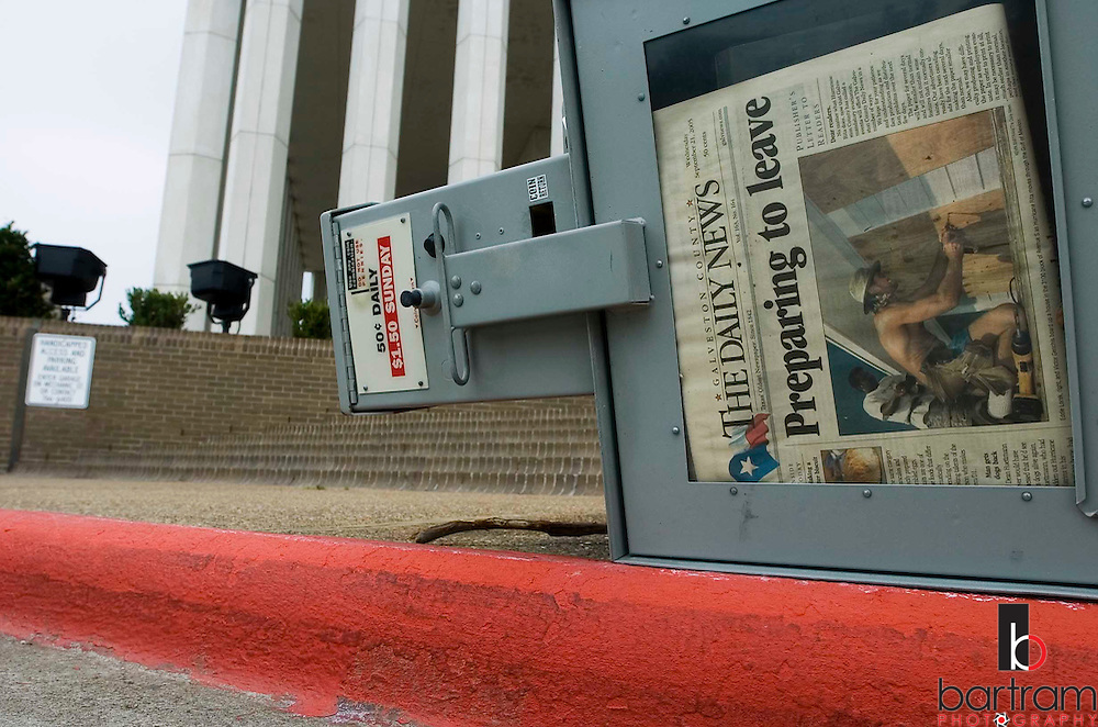 An overturned newspaper vending machine contains Wednesday's edition featuring stories on Hurricane Rita preparations on Saturday, Sept. 24, 2005 following the landfall of Hurricane Rita.  (AP Photo/The Galveston County Daily News, Kevin Bartram)