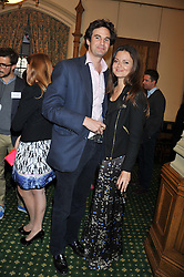 RUPERT FINCH and LADY NATASHA RUFUS ISAACS at a reception for The Mirela Fund in partnership with Hope and Homes for Children hosted by Natalie Pinkham in The Churchill Room, House of Commons, London on 30th April 2013.