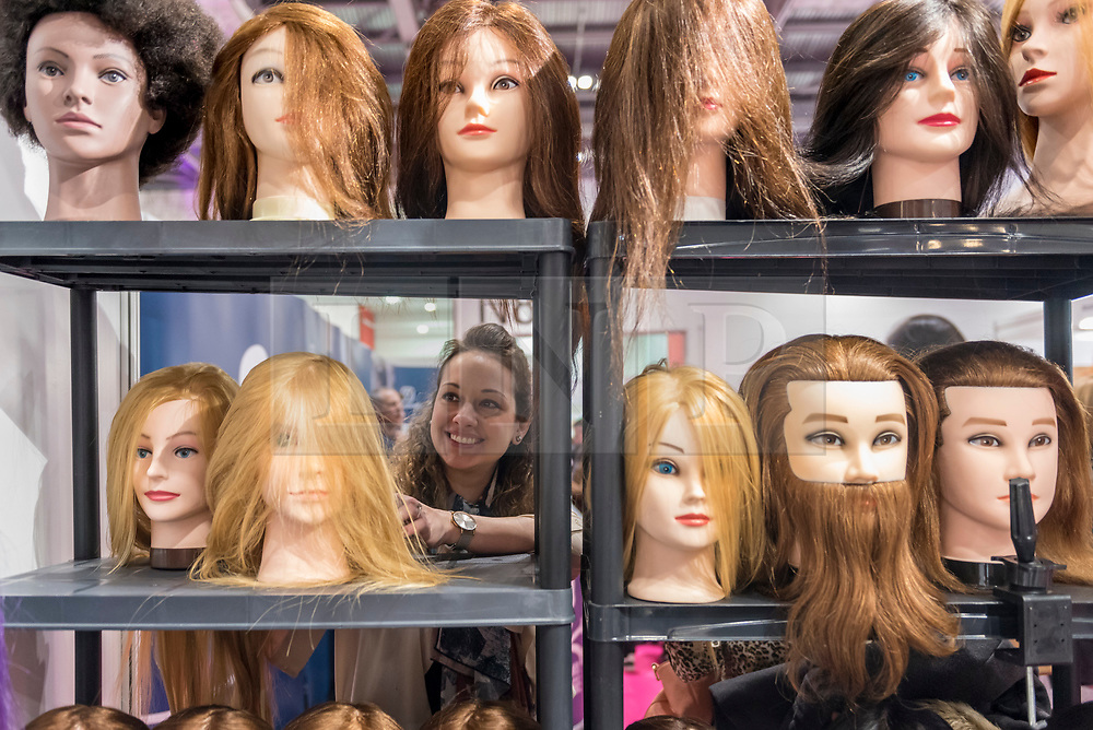 © Licensed to London News Pictures. 25/02/2019. LONDON, UK. A visitor examines wigs at Professional Beauty, the UK's largest beauty and spa trade show, taking place at Excel London in Docklands.  Photo credit: Stephen Chung/LNP