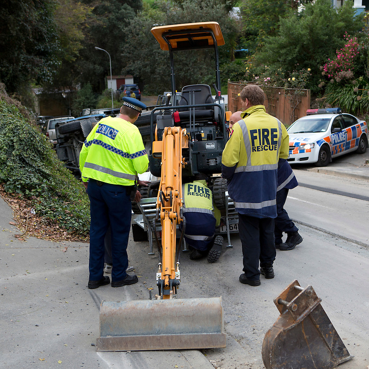 A driver had a lucky escape when the digger he was unloading tipped the truck over talks to police, Napier,  New Zealand, Friday, 25 May 2012, Photo: SNPA / John Cowpland