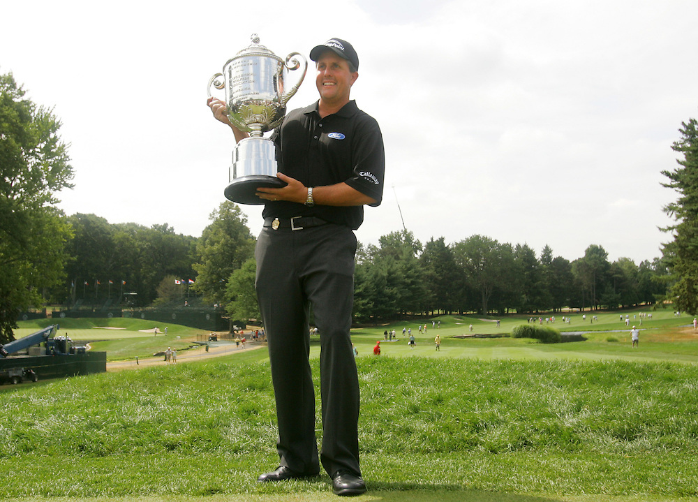 Phil Mickelson of the US holds the Wannamaker trophy after winning the 2005 PGA Championship at Baltusrol Golf Club in Springfield, New Jersey, Monday 15 August 2005. Mickelson clinched his second major title with a one-shot victory on Monday.