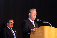 Montgomery County Democratic Party chair Mark Owens (left) and Former Congressman and former U.S. Ambassador Tony P. Hall during the Montgomery County Democratic Party's annual Frolic for Funds at the Dayton Convention Center in downtown Dayton, Thursday, March 29, 2012.  Hall is delivering remarks after receiving the lifetime achievement award at the event.
