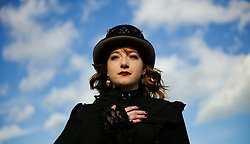© Licensed to London News Pictures. <br /> 01/11/2014. <br /> <br /> Whitby, Yorkshire, United Kingdom<br /> <br /> Sarah Potter from Wolverhampton attends the 20th anniversary of the Whitby Goth Weekend. <br /> <br /> The event this weekend brings together thousands of extravagantly dressed followers of Victoriana, Steampunk, Cybergoth and Romanticism who all visit the town to take part in celebrating Gothic culture. This weekend marks the 20th anniversary since the event was started by local woman Jo Hampshire.<br /> <br /> Photo credit : Ian Forsyth/LNP