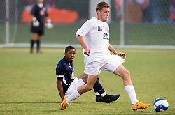 Hofstra forward Johannes Grahn (20) passes the ball after beating Virginia Cavaliers forward/midfielder Ross LaBauex (8).  The Virginia Cavaliers faced the Hofstra Pride  in NCAA men's soccer at Klockner Stadium on the Grounds of the University of Virginia in Charlottesville, VA on September 7, 2008