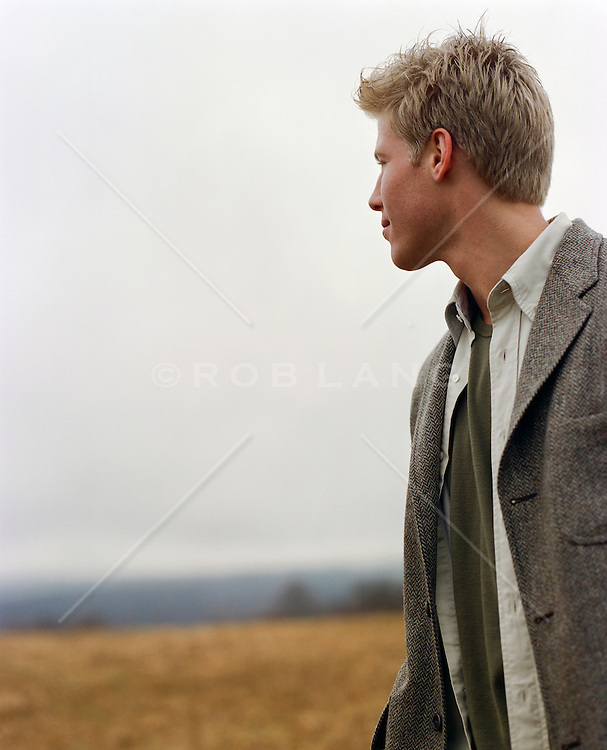 man looking out on a foggy field