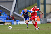 Curtis Main of Oldham Athletic is fouled by Tom Anderson of Chesterfield during the Sky Bet League 1 match between Oldham Athletic and Chesterfield at Boundary Park, Oldham, England on 28 March 2016. Photo by Simon Brady.
