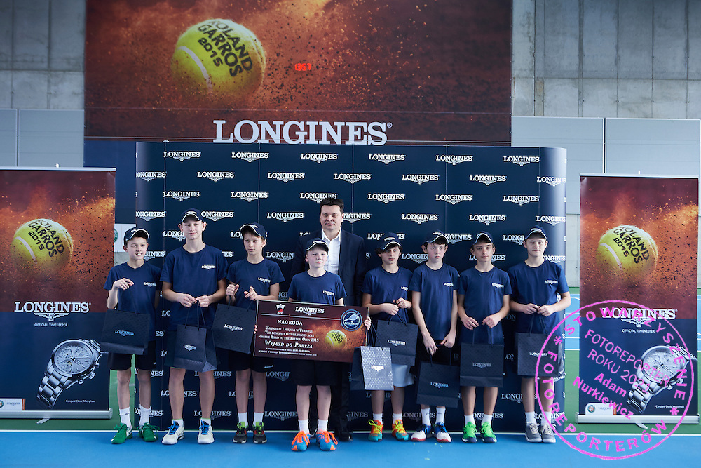(L)  Maksymilian Kasnikowski from Poland under-14 tennis player and (R) Leszek Pilch from Longines watch while victory ceremony during the Longines Future Tennis Aces 2015 at Tuan Tennis Club in Jozefoslaw near Warsaw on April 11, 2015.<br /> <br /> Poland, Warsaw, April 11, 2015<br /> <br /> Picture also available in RAW (NEF) or TIFF format on special request.<br /> <br /> For editorial use only. Any commercial or promotional use requires permission.<br /> <br /> Mandatory credit:<br /> Photo by &copy; Adam Nurkiewicz / Mediasport