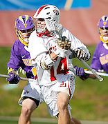 SHOT 5/11/13 5:39:57 PM - Denver's Wesley Berg #14 attacks in front of a pair of Albany defenders during their first round NCAA Tournament lacrosse game at the Peter Barton Lacrosse Stadium on the University of Denver campus Saturday May 11, 2013. Berg scored eight goals in the game helping lead the University of Denver to a 19-14 victory. (Photo by Marc Piscotty / © 2013)