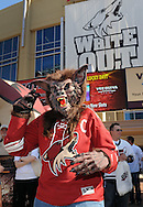 May 13, 2012; Glendale, AZ, USA; Phoenix Coyotes fan wears a coyote mask prior to the first period of game one of the Western Conference finals of the 2012 Stanley Cup Playoffs at Jobing.com Arena.  Mandatory Credit: Jennifer Stewart-US PRESSWIRE