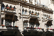ornate neoclassical building on Strada Stavrapoleos; balconies with flowers; Caru cu Bere; Bucharest; Romania