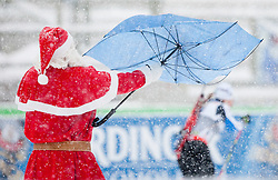 Santa Clause with umbrella during Ladies 7,5 km Sprint of the e.on IBU Biathlon World Cup on Thursday, December 14, 2012 in Pokljuka, Slovenia. The third e.on IBU World Cup stage is taking place in Rudno polje - Pokljuka, Slovenia until Sunday December 16, 2012. (Photo By Vid Ponikvar / Sportida.com)