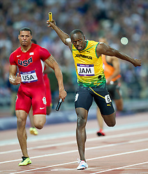 © Licensed to London News Pictures. 11/08/2012. London,UK.Usain Bolt  of Jamaica celebrates after beating Ryan Bailey  of the US on the finish line to win men's 4x100m final at the London 2012 Olympic Games Athletics, Track and Field events at the Olympic Stadium .  Photo credit : Bogdan Maran/LNP/BPA