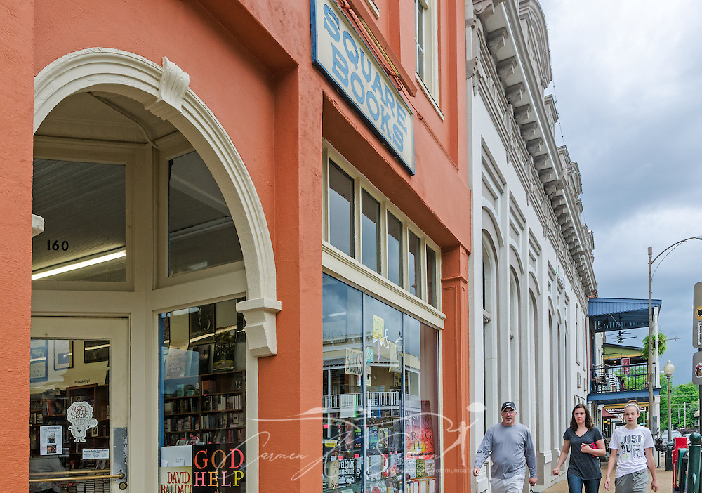 Shoppers walk past Square Books, May 31, 2015, in Oxford, Mississippi. The family-owned bookstore was founded in 1979 by Richard and Lisa Howorth and is considered to be one of the catalysts prompting downtown revitalization in Courthouse Square. (Photo by Carmen K. Sisson/Cloudybright)