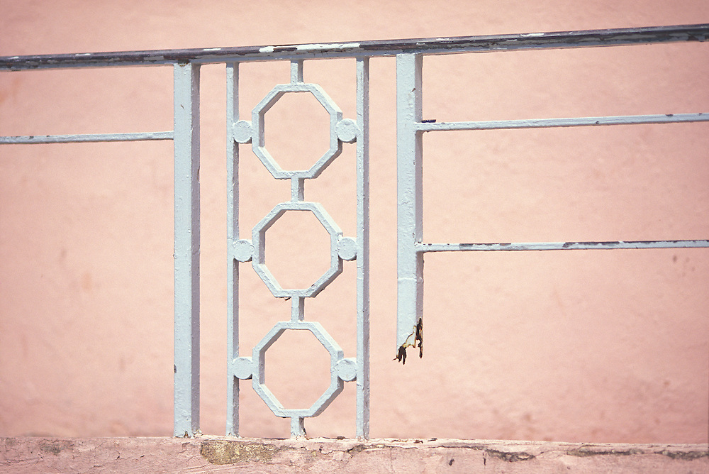 A vintage Art Deco railing on the Congress Hotel on Ocean Drive was broken and in bad repair when this photo was made in the early 1990s, but it was still graceful. The railing has since been replaced by a modern one of different design. The hotel was designed by architect Henry Hohauser in 1935.