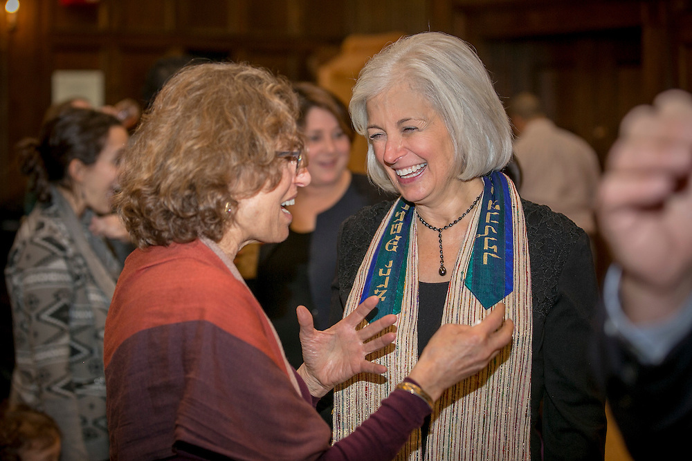 January 15, 2016, Boston, MA:<br /> Rabbi Elaine Zecher greets guests at an Oneg following Qabbalat Shabbat services at Temple Israel in Boston, Massachusetts Friday, January 15, 2016. <br /> (Photo by Billie Weiss/Temple Israel)
