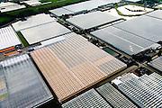 Nederland, Zuid-Holland, Gemeente Westland, 28-09-2014; Glazen stad, Kassengebied Westland, omgeving 's-Gravenzande. Kassen met groeilampen (assimilatieverlichting).<br /> Greenhouses area in the West of the Netherlands, the heart of the production of vegetables and fruit for export. Between The Hague and Rotterdam.<br /> luchtfoto (toeslag op standard tarieven);<br /> aerial photo (additional fee required);<br /> copyright foto/photo Siebe Swart