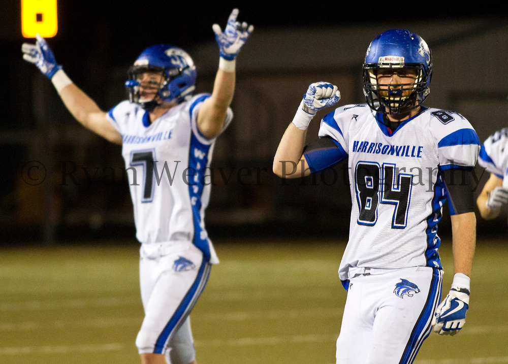 Kurt Poisal, right, and Joe Bowers celebrate Harrisonville beating Grain Valley 24-21 Friday and advancing to the Class 4 quarterfinal. Harrisonville will face 12-0 Webb City.
