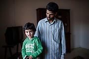 2 Febbraio 2016, Milena, Sicilia, Italia - Sayed Yousof Hussaini, 29 anni cin suo figlio.