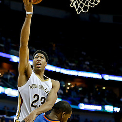 Dec 2, 2014; New Orleans, LA, USA; New Orleans Pelicans forward Anthony Davis (23) shoots over Oklahoma City Thunder forward Kevin Durant (35) during a game at the Smoothie King Center. The Pelicans defeated the Thunder 112-104. Mandatory Credit: Derick E. Hingle-USA TODAY Sports