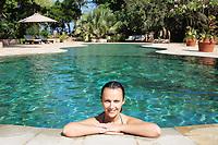 beautiful brunette caucasian relaxing in a swimming pool