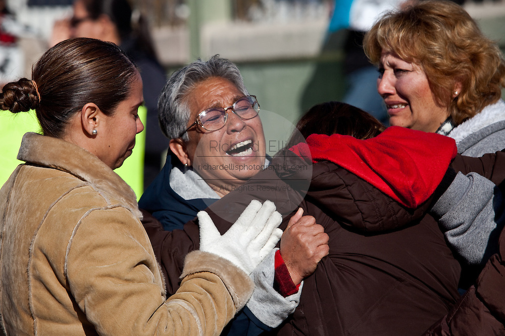 Relatives of Jaime Irigoyen Flores, a 19-year-old baseball player and law student, breakdown after they found out their son was found dead as they gathered to protest outside the gates of the Mexican Army base in Juarez, Mexico January 14, 2009. Flores was reportedly grabbed by the military from his home and found executed the neat mourning. An ongoing drug war has already claimed more than 40 people since the start of the year. More than 1600 people were killed in Juarez in 2008, making Juarez the most violent city in Mexico.    (Photo by Richard Ellis)