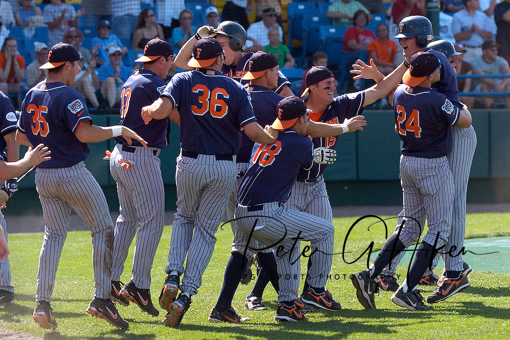 The Cal State Fullerton bench erupts off the bench to celebrate scoring the go ahead runs in the top of the ninth inning against Georgia Tech.  Cal State Fullerton eliminated Georgia Tech with a 7-5 win at the College World Series at Rosenblatt Stadium in Omaha, Nebraska, June 18, 2006.