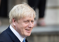 © Licensed to London News Pictures. 23/07/2019. London, UK. Newly elected Conservative Party leader Boris Johnson smiles as he leaves party headquarters after attending a reception. Photo credit: Peter Macdiarmid/LNP