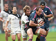Sergio Parisse of Stade Francais is tackled by Shaun Sowerby. Stade Toulousain v Stade Francais, 9eme Journee, Top 14, Rugby, Stade Ernest Wallon, Toulouse, France, 29th October 2011.