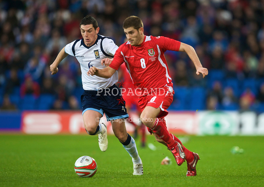 CARDIFF, WALES - Saturday, November 14, 2009: Wales' Ched Evans and Scotland's Graham Dorrans during the international friendly match at the Cardiff City Stadium. (Pic by David Rawcliffe/Propaganda)
