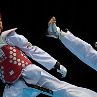Yu-Jen Huang (L) of Taiwan fight with Donghun Joo (unseen) of South Korea during the Taekwondo Men's under 55kg final at International Expo Centre of the Nanjing 2014 Youth Olympic Games in Nanjing, China 18 August 2014. The Nanjing Youth Olympic Games 2014 runs from from 16 to 28 August 2014.