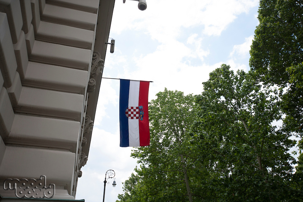 Low angle view of Croatian flag hanging on parliament building; Zagreb; Croatia