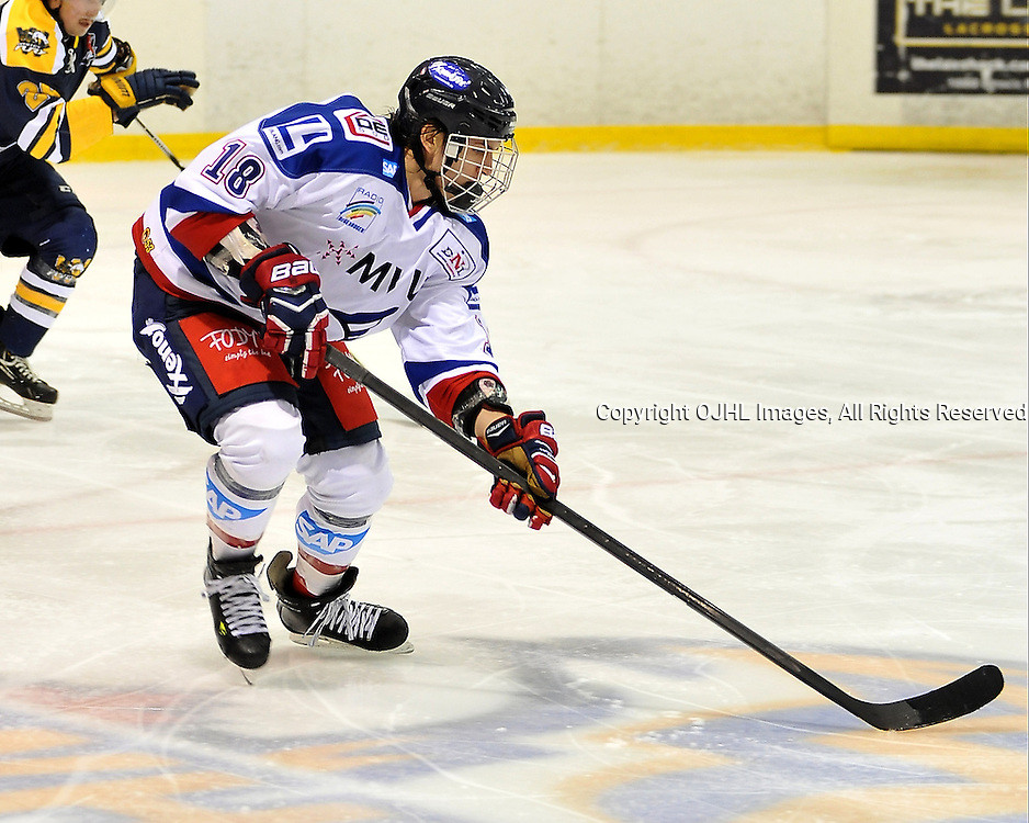 WHITBY, ON - Nov 27: Ontario Junior Hockey League International Exhibition between Whitby Fury and the visiting Adler Mannheim from Germany. Yannis Walch #18 of Team Germany skates with the puck during first period game action.<br /> (Photo by Shawn Muir / OJHL Images)