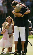 Phil Mickelson of the embraces his wife Amy after winning the 2005 PGA Championship at Baltusrol Golf Club in Springfield, New Jersey, Monday 15 August 2005. Mickelson clinched his second major title with a one-shot victory on Monday. At left are Mickelson's daughters.