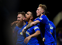 Football - 2018 / 2019 Emirates FA Cup - Fourth Round: AFC Wimbledon vs. West Ham United<br /> <br /> AFC Wimbledon's Scott Wagstaff (left) celebrates scoring his side's third goal and his second with Kwesi Appiah and Joe Pigott, at Cherry Red Records Stadium (Kingsmeadow).<br /> <br /> COLORSPORT/ASHLEY WESTERN