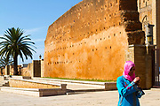 RABAT, MOROCCO - 27th May 2014 - Person walking past the old walls enclosing Kasbah of the Udayas, Rabat Medina, Morocco.