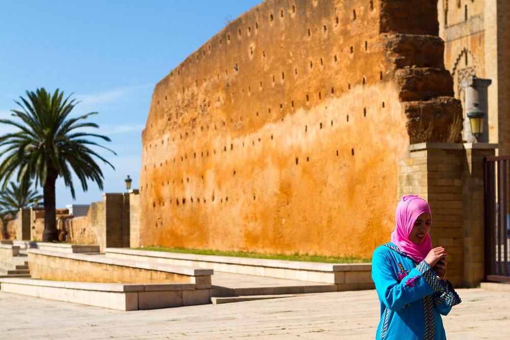 RABAT, MOROCCO - 27th May 2014 - Person walking past the old walls enclosing Kasbah of the Udayas, Rabat Medina, Morocco.
