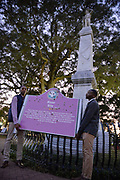 Students Tyler Yarbrough, left in vest and Curtis Hill both students at The University of Mississippi aka Ole Miss, carry the bullet ridden Emmett Till memorial sign onto campus by the Grove where the Confederate Statute has been on display for decades. They said they were doing this because the Confederate statute is an injustice and should be removed. Both students were part of a symposium earlier on campus as part of the Remembering Emmett Till event. Months earlier 3 white Ole Miss students shot up the sign the boys are carrying, it  was at Graball landing marking the site where the body of Emmett Till was removed from the Tallahatchie River and then the white Ole Miss students posted pictures on it in social media.Copyright ©Suzi Altman #till